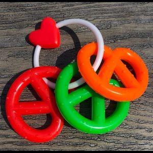 Vintage plastic baby rattle noisy pretzels ring